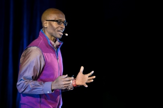 """Brian Thompson presents his talk """"Connecting Young Minorities to their Future Selves"""" at TEDxDePaulUniversity Tuesday, April 18, 2017, in the Lincoln Park Student Center. TEDxDePaulUniversity is an independently run, self-organized event. Through the theme """"Courage to Connect"""" 10 speakers from across the DePaul community challenged thoughts and inspired ideas through a series of engaging talks and presentations. (DePaul University/Jeff Carrion)"""